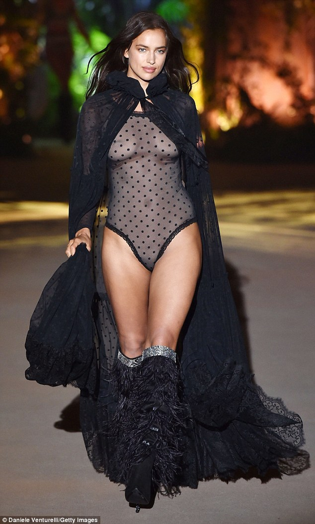 Dare to bare: Irina Shayk, 32, left nothing to the imagination as she slipped her curves into a sheer lace lingerie while strutting down the Intimissimi runway in Verona, Italy, on Tuesday