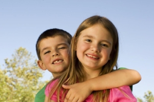 Young girl and boy with arm around her.jpg