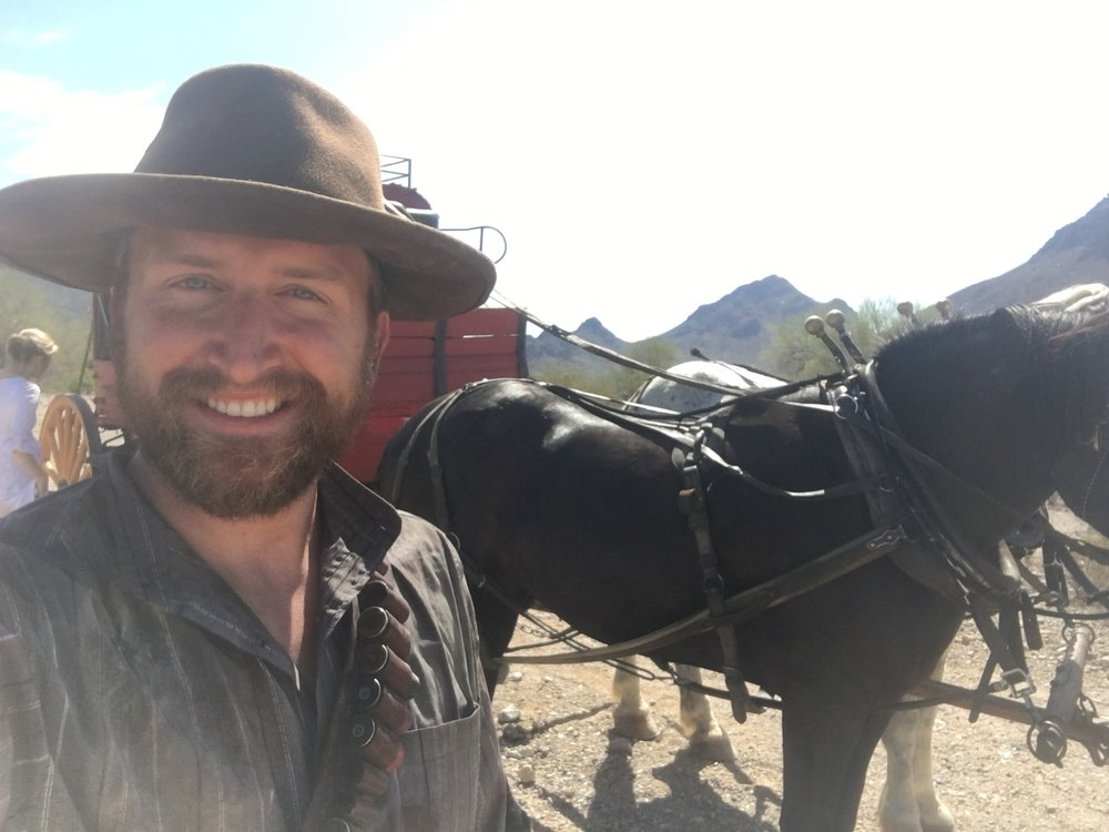 Matt Boone taking a selfie with the horses
