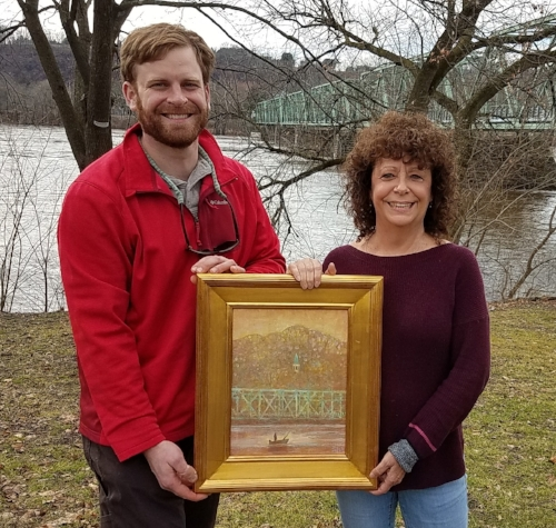 "Karen Harmon received her prize for the ""Beauty"" contest next to the Delaware River from Mark Zakutansky, Director of Conservation Policy Engagement at the Appalachian Mountain Club."