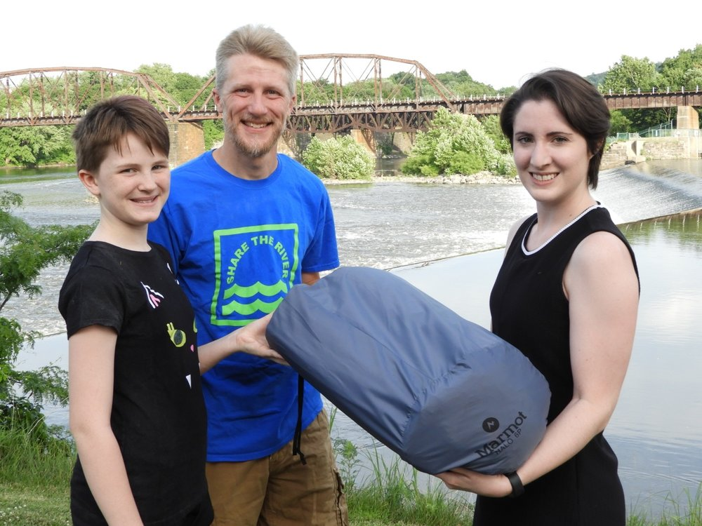 Matt and Madi receiving their contest prize, a Marmot Halo tent, from Margaret Wilson of the Appalachian Mountain Club.