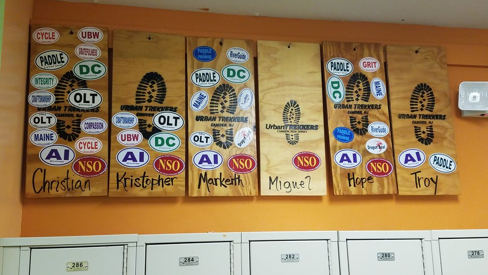 Student boards featuring customized stickers to represent the programs each student has taken part in alongside the Office of Experiential Learning