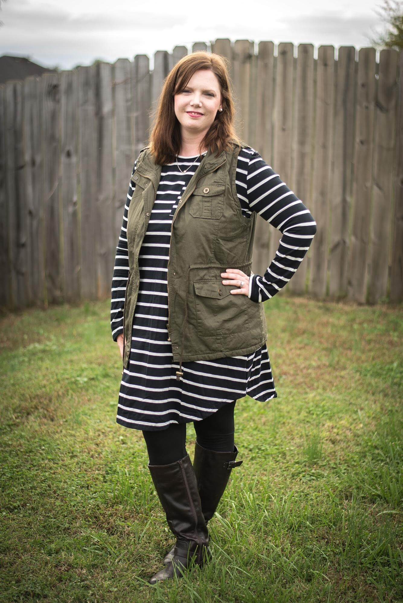Stripe swing dress + utility vest + leggings + boots... simple but comfy mom outfit! Comfy but stylish mom outfit ideas for fall. These outfits are fashionable but not too trendy! They are all created from a wardrobe capsule-like plan for moms created by the blog. Such a helpful guide for not looking frumpy! And I love the guest blogger's boutique... cute stuff that is actually affordable! Shows you how to style a simple black dress, leopard scarf, denim jacket, striped swing dress, utility vest