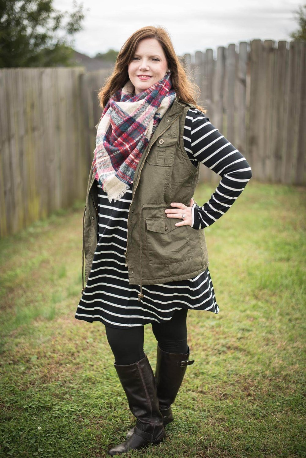 aa1ad87dafe Stripe swing dress + utility vest + plaid scarf + leggings + boots.