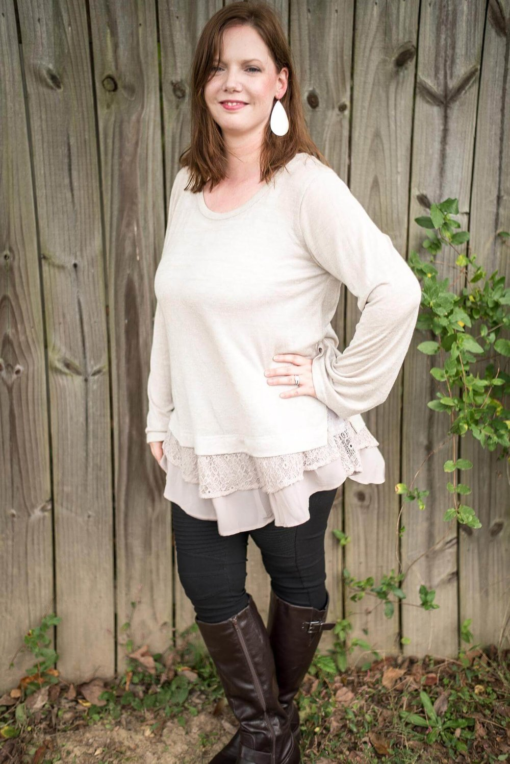 Layered lace tunic sweater + black moto leggings + tear drop earrings... simple but comfy mom outfit! Comfy but stylish mom outfit ideas for fall. These outfits are fashionable but not too trendy! They are all created from a wardrobe capsule-like plan for moms created by the blog. Such a helpful guide for not looking frumpy! And I love the guest blogger's boutique... cute stuff that is actually affordable! Shows you how to style a simple black dress, leopard scarf, denim jacket, striped swing dress, utility vest, plaid scarf, and tunic top! #fall #easy #clothes #mom #fashion #outfits #tips # ideas #easy #style