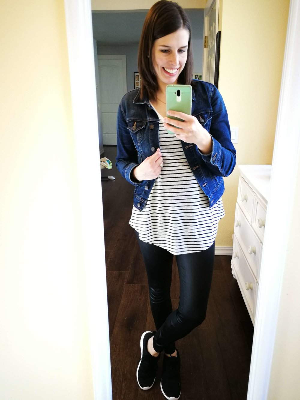 How to wear faux leather leggings. Cute casual chic outfit idea for winter or fall- Striped tee with round hem + denim jacket + sneakers.