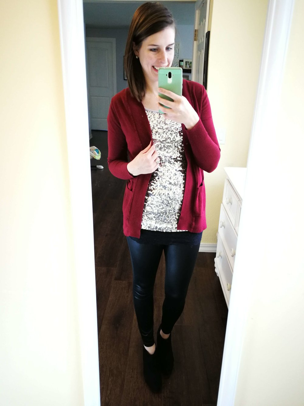 What to wear with leather leggings for a night out! Chic and classy outfit idea for winter or fall  with sequin top + cardigan + black booties.