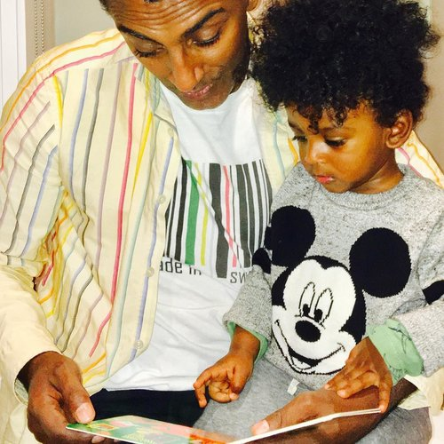 Chef Marcus Samuelsson with son reading