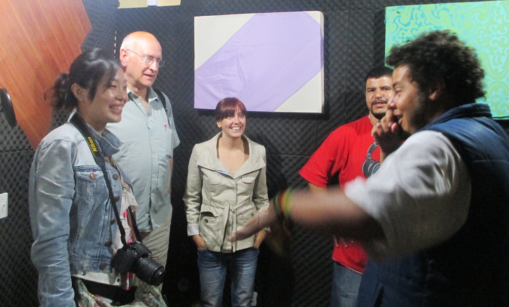 Fig.6: Journeys for Change participants join founders of social business A Banka at their music studio in one of Sao Paulo's most dangerous slum areas