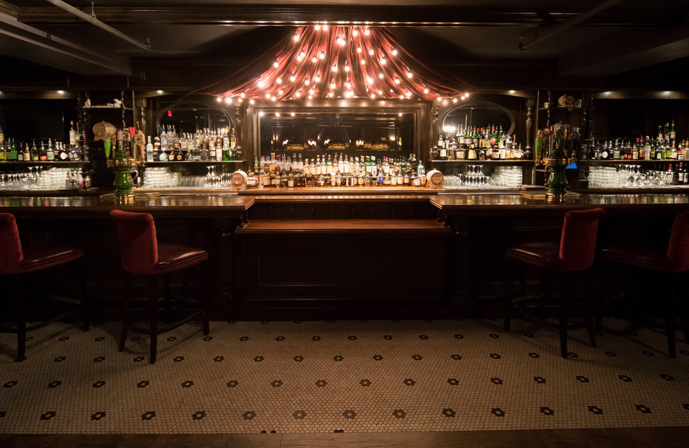 Salon style venue and bar in the back room at Carrie Nation, Boston's Beacon Hill