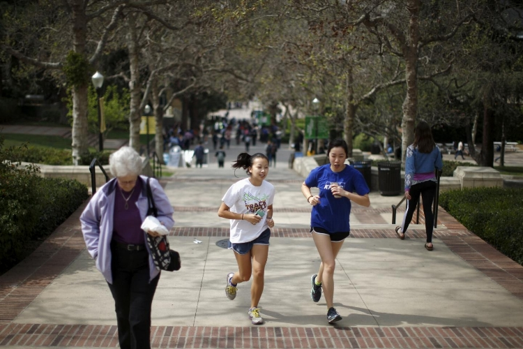 """Students jog on the UCLA campus in Los Angeles on March 4. Tammi Rossman Benjamin writes that Jewish students are shunned from participating in student government, rejected from progressive social justice activities such as pro-choice rallies, anti-rape demonstrations, Black Lives Matter events and racial justice conferences and ostracized from areas of campus life because of their """"Jewish agenda"""" or presumed support for Israel at schools including UCLA, Stanford University, San Diego State University, UC Santa Cruz, Northwestern University, Brooklyn College and SUNY Albany. Lucy Nicholson/reuters"""