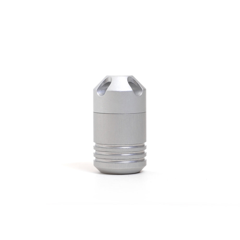 CAPSULE The waterproof storage Capsule keeps your details safe and dry ready for survival as it tethers to your everyday gear.