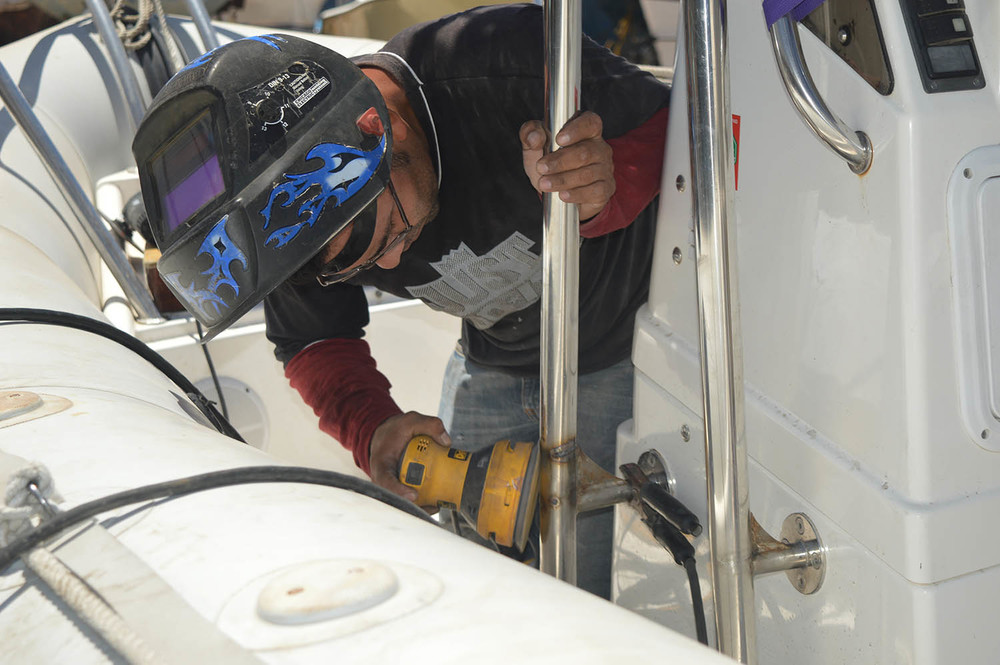 Able Pino of Berkovich Boat Works working his magic to weld the T-top on the Zodiac!