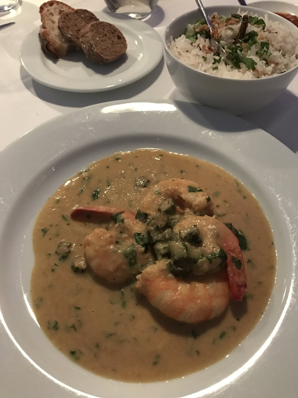 First Meal on Arrival: Prawn curry & lady's fingers served with basmati rice - IBO Restaurante