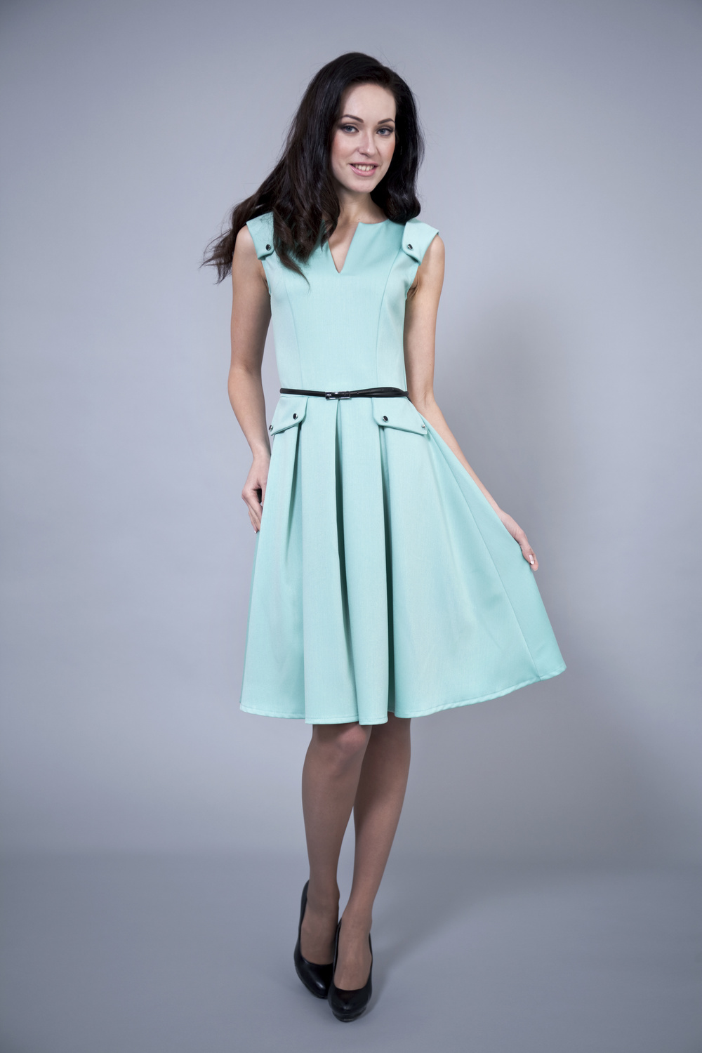 Pastel tones of rose, teal and pale green are abundant