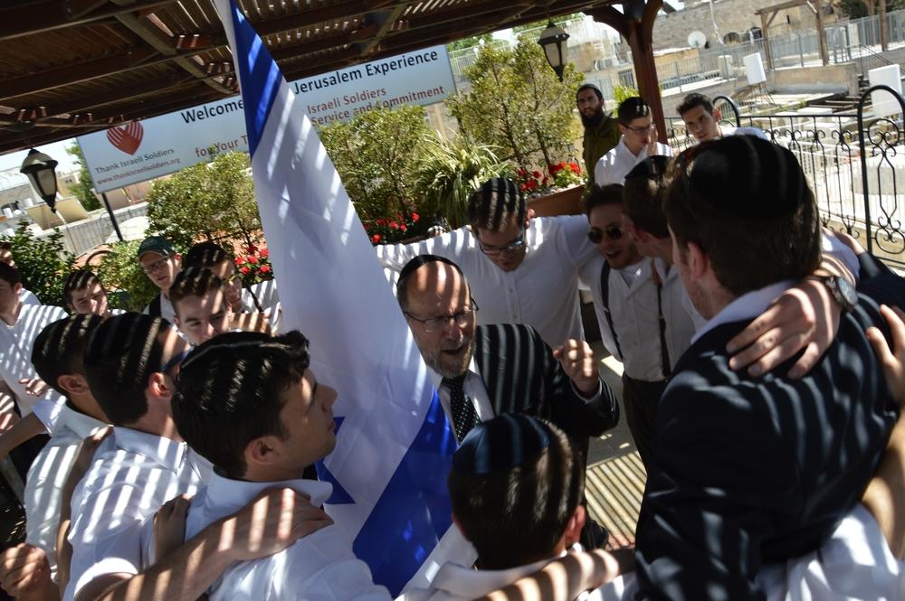 Dancing with Israel flag on Yom Yerushalayim
