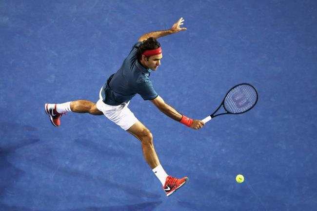 hi-res-464044447-roger-federer-of-switzerland-plays-a-backhand-in-his_crop_exact.jpg