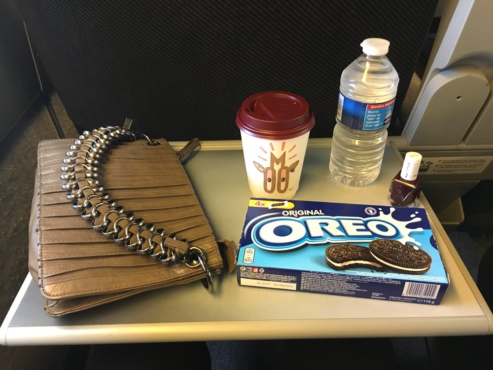Travel necessities: coffee, water, cookies and nail polish!