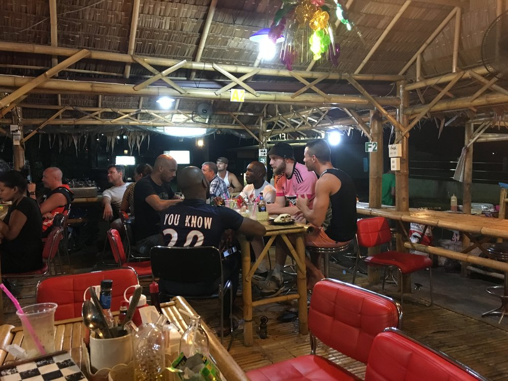 Cant remember the name of this place but it's close to Phuket top team. Great mixed grilled platters if u eat meat. Kaos during rush hour tho!