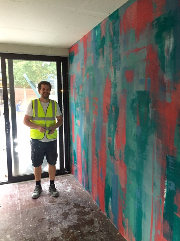 Charles Snell with his amazing piece of wall art that has added a splash of colour to the shop wall. He added paint pigment to plaster and put it straight onto plasterboard.  You can contact Charles via email - chtsnell@googlemail.com