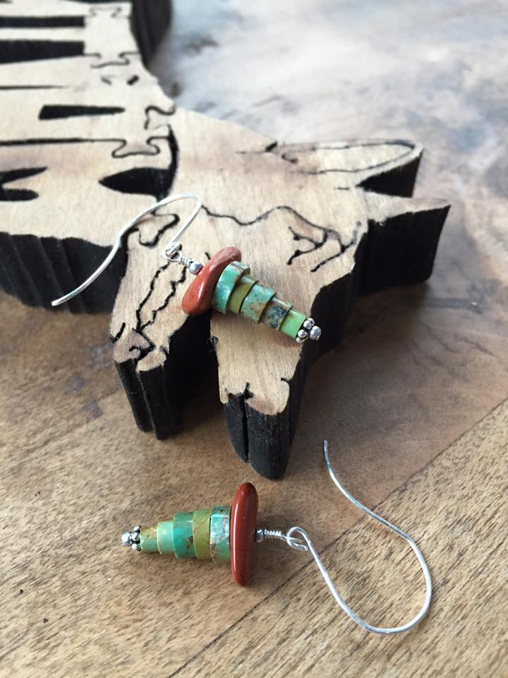Turquoise heishi beads, salvaged from a vintage piece and repurposed here with red jasper hats and sterling silver daisies. Handmade sterling silver ear wires. $30.
