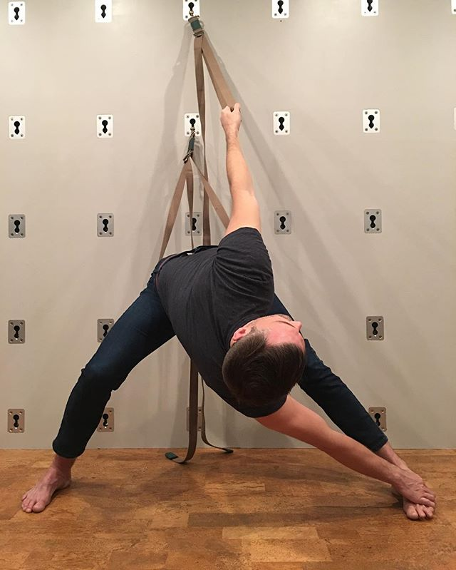 Parivrtta Prasarita Padottanasana with a foot grab and the opposite knee bent.  Have one Karunta strap wrapped around top of femurs to keep hips squared, and I'm hold another one, a level up, in my free hand.