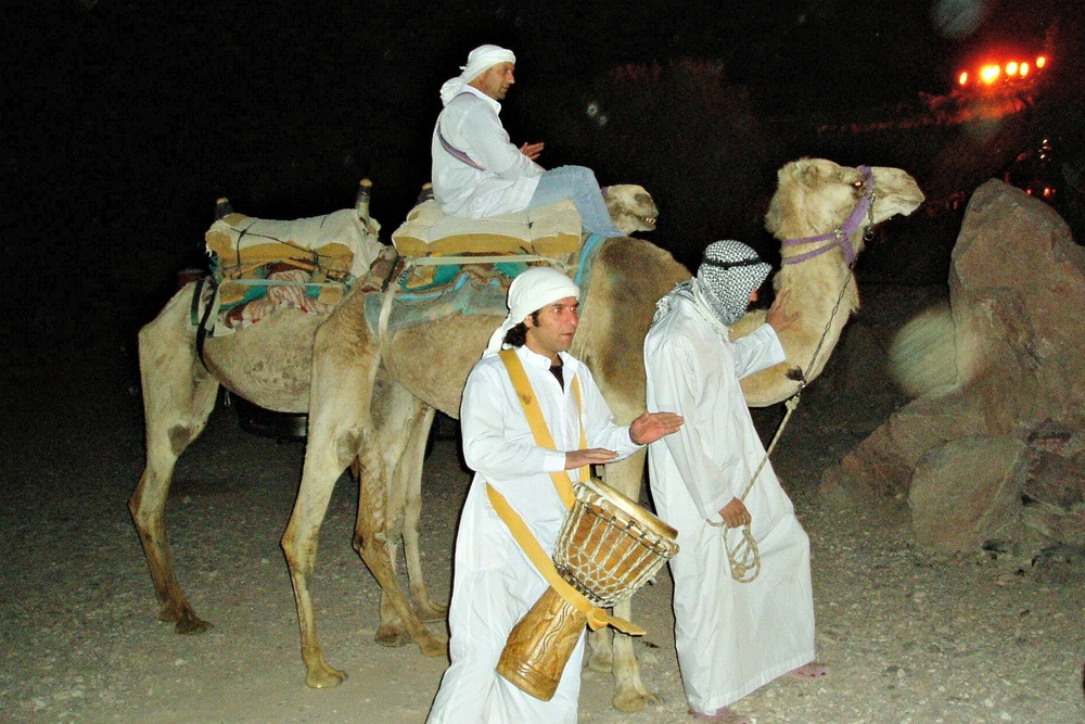 P3140114 Camels and minders who led IMBC participants to banquet in the desert.jpg