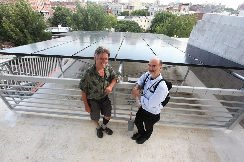 "Ray Sage and Paul Castrucci, the developers of Brooklyn's ""Passive"" House, show off their solar panels   (BYRON SMITH/FOR NEW YORK DAILY NEWS)"