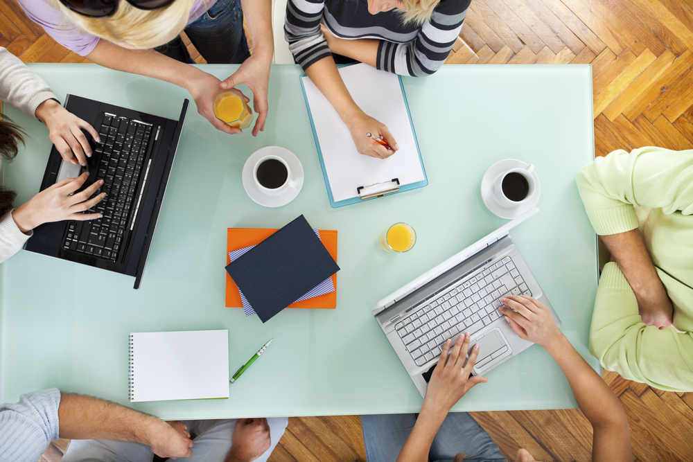 Group-of-people-with-two-laptops-at-a-meeting-000018278455_Full.jpg