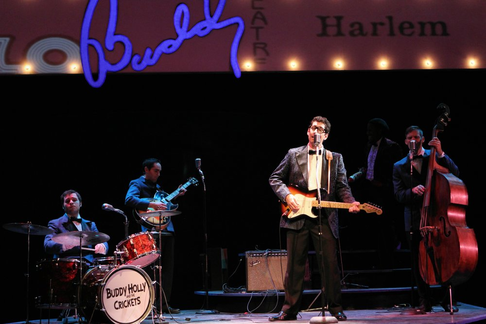 "Nick Freeman as Buddy Holly, History Theatre's 2011 production of ""Buddy! The Buddy Holly Story"" Zach Spicer (drums), Nick Freeman, Blake Foster (Sonny Curtis) and Ryan Janssen (Joe Maudlin)"
