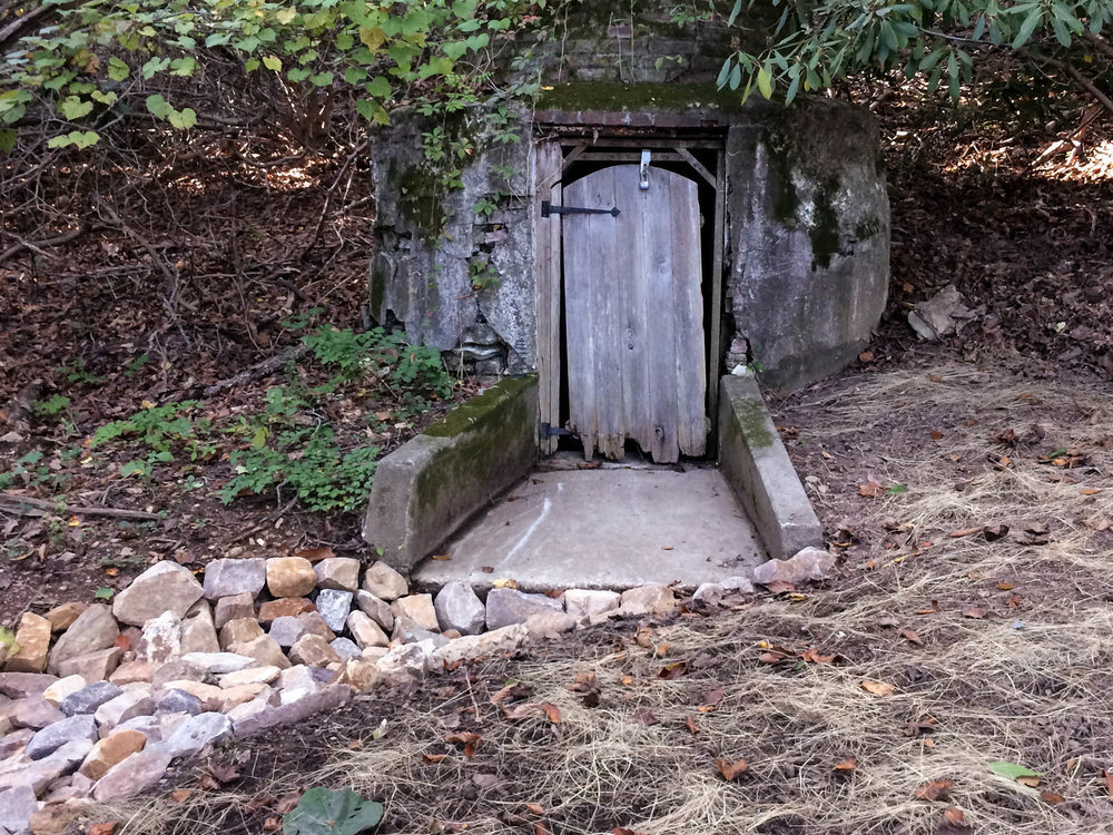 Here Terren Landscapes combined an original culvert built during the first half of the 20th century with a swail made of ecologically friendly stone. The swail is designed to resist erosion from runoff while allowing the water to be absorbed into the ground.