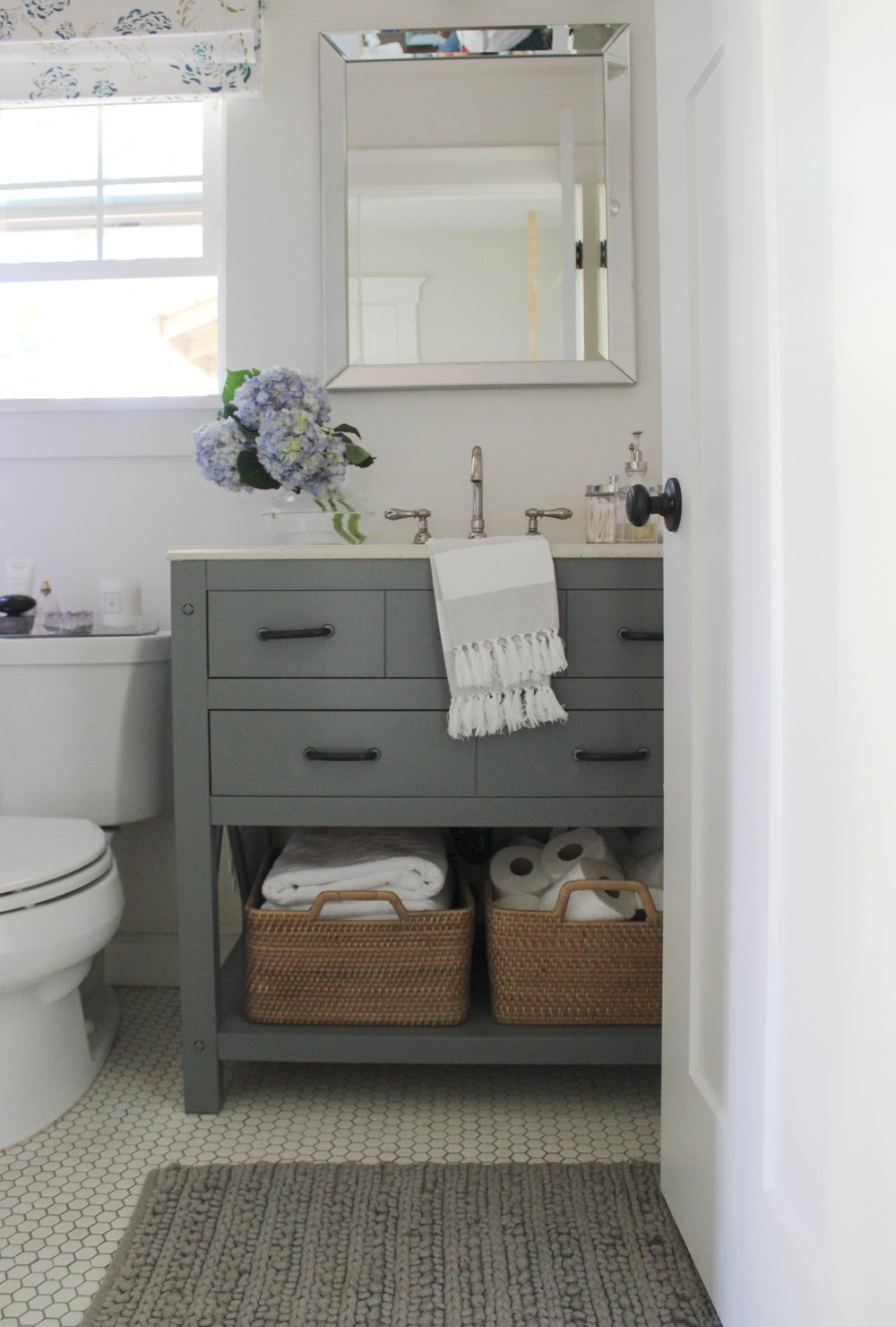 I Painted The Bathroom Vanity, Hung A Mirror And Adding A New Light Fixture  Added Baskets In The Open Shelf Area To Hold Sheets And Towels And Thatu0027s  Where ...