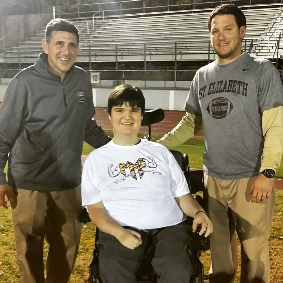 (left to right): Athletic Director Joe Papili, Muscle Champion Mike Smith, and Offensive Coordinator Joe Wright after a win against Saint Mark's High School last season.