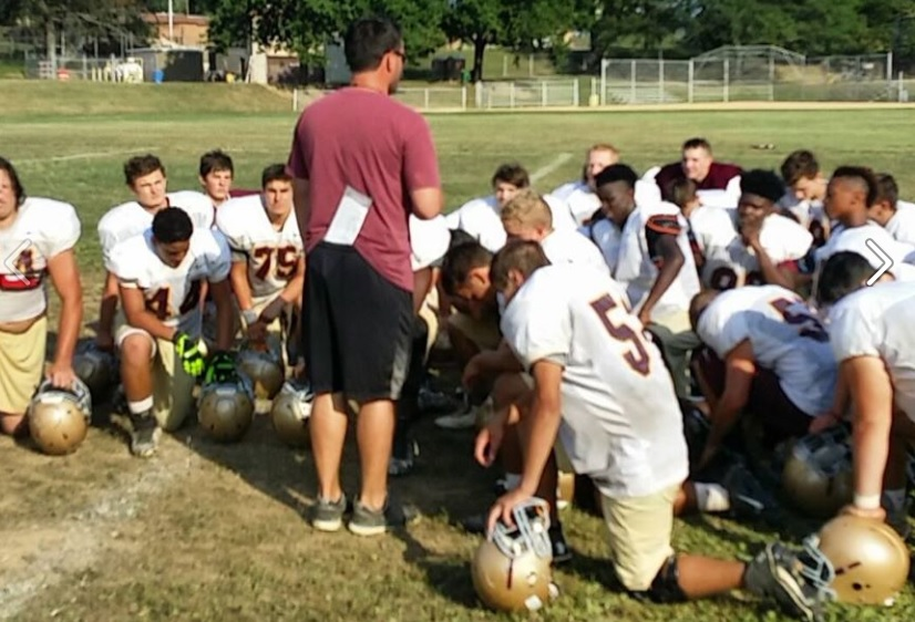 Offensive Coordinator, Joe Wright, speaking to the team during a summer practice.