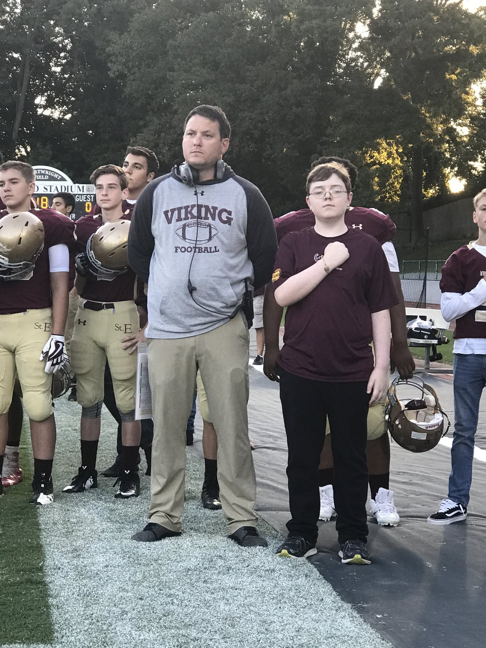 Head Football Coach, Joe Wright, and Muscle Champion, Max French, stand for the National Anthem!