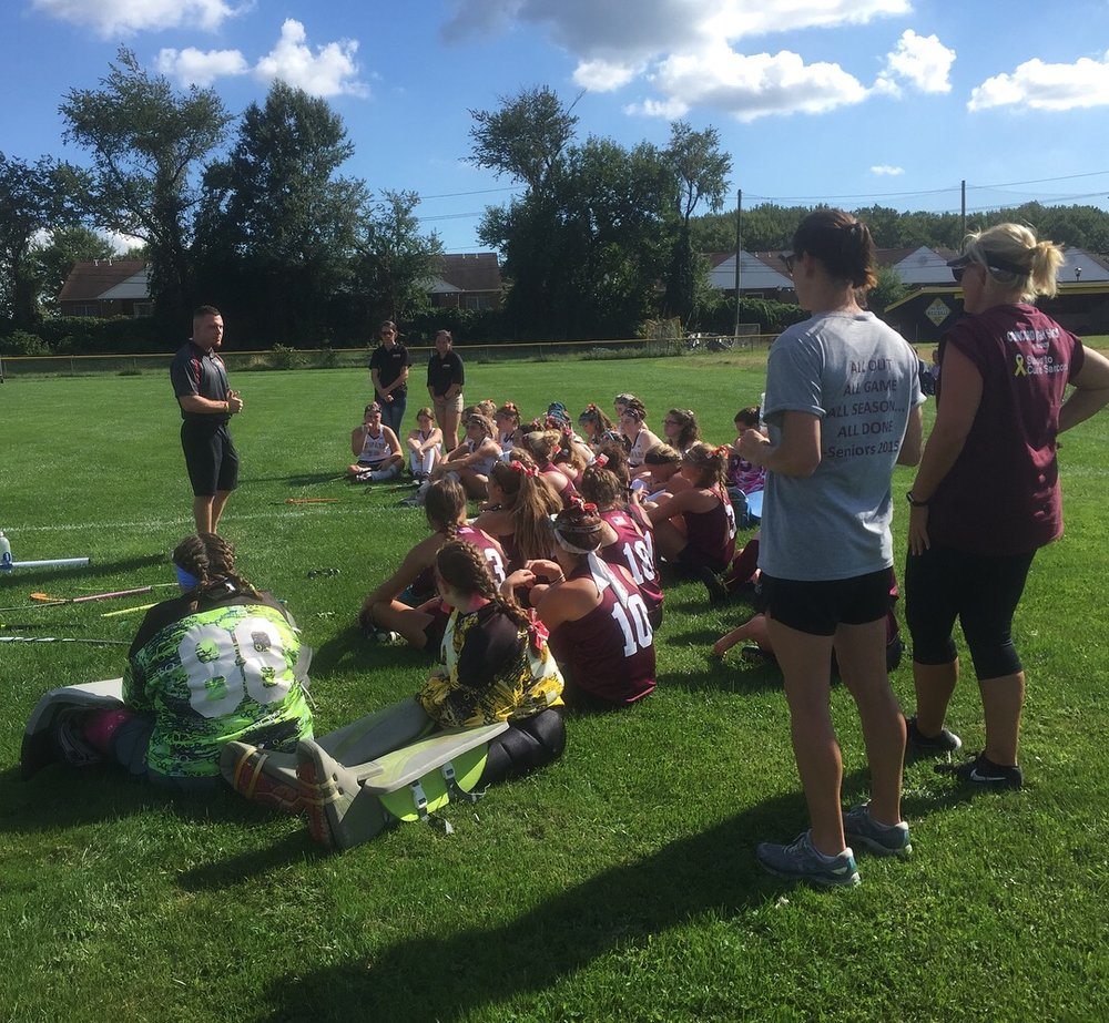 President, Rob DeMasi, delivering speech to Newark & Concord High School Field Hockey Teams