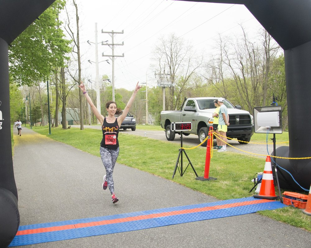 NFL Cheerleader, U.S. Navy Nurse, MMF Advocate, and MUSCLE CHAMPION, Rachel Engler, crossing the finish line at the 1st Annual MMF Delaware RUN for STRENGTH 5k! Rachel received treatment for myasthenia gravis, an autoimmune form of muscle disease, just one week before completing this race!