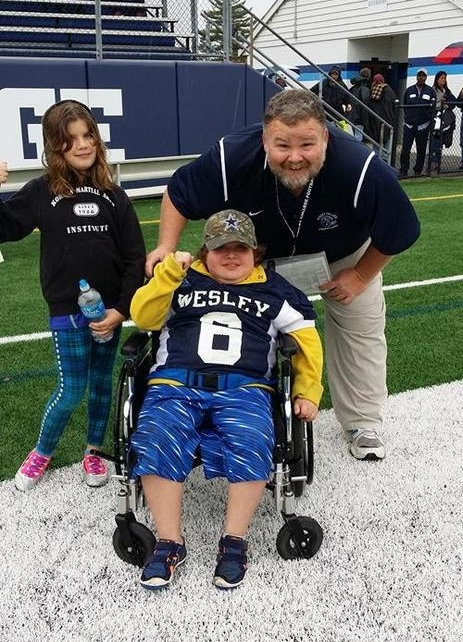 Coach Mike Drass welcomes Muscle Movement Fnd. Muscle       Champion, Eddie Hazeldine and his sister, Sara, at Drass Field!