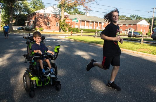 Muscle Movement Fdn. Muscle Champion, Harry Smith, and Josh Scheck race down the road!    Photo Credit: EvaJo Alvarez