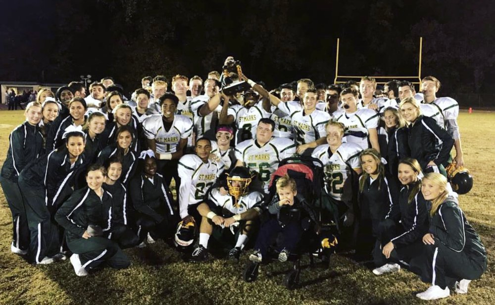 Saint Mark's Spartans (2017) celebrate with MMF Muscle Champion, Roman Graham!