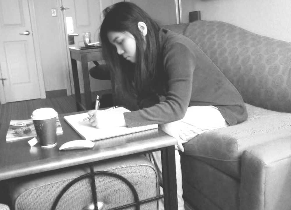 Lavennz Ooi drawing in the hotel room when she first arrived at Maine in 2013.
