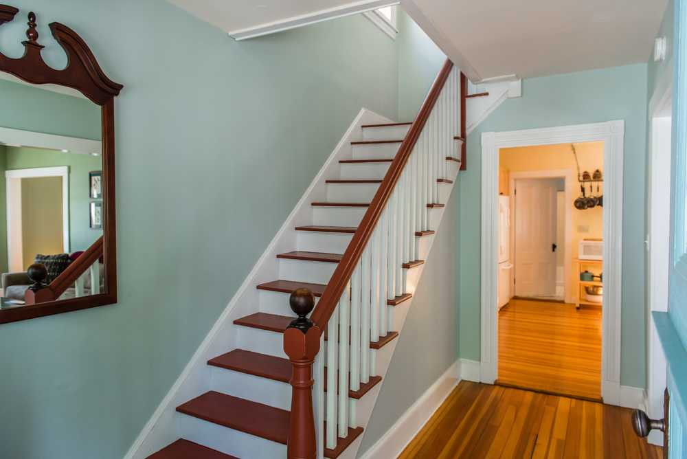 Entryway leading to kitchen, living room to right, and upstairs bedrooms.
