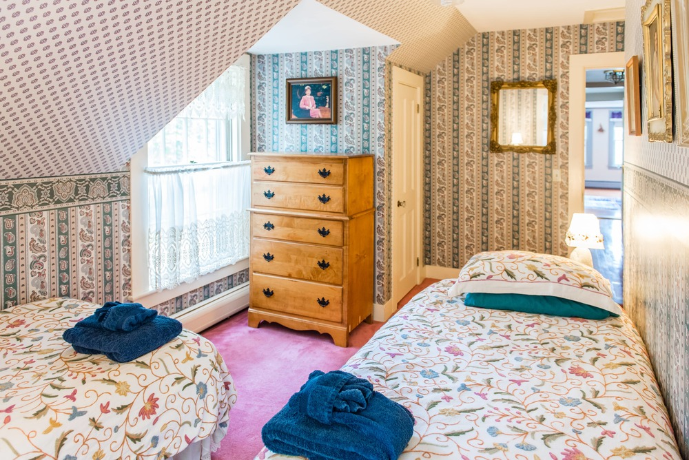 Upstairs bedroom with two twin beds.