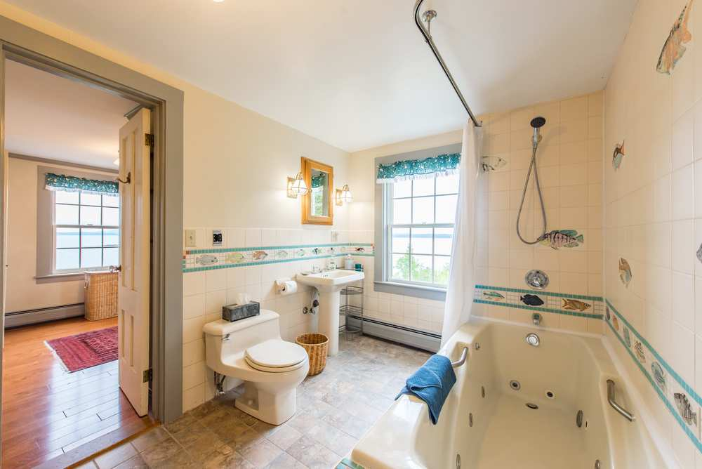 Master suit bathroom with jetted tub, ocean views and hand painted tiles.