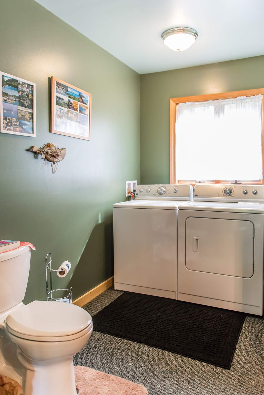 Downstairs bathroom with full laundry facilities.