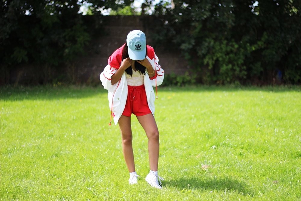 90'S BABY TRACK JACKET, RACE YOU TRACK SHORTS, OFEILA LACE BODYSUIT, CONVERSE AND ADIDAS CAP