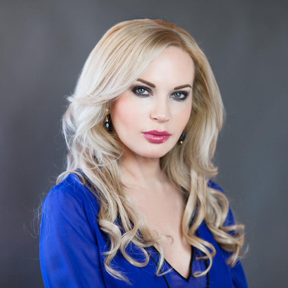 Olga Zavialova Lucero  Owner, RN