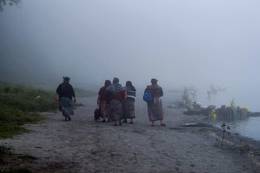 Mayan women return from making an offering at Lake Chicabal