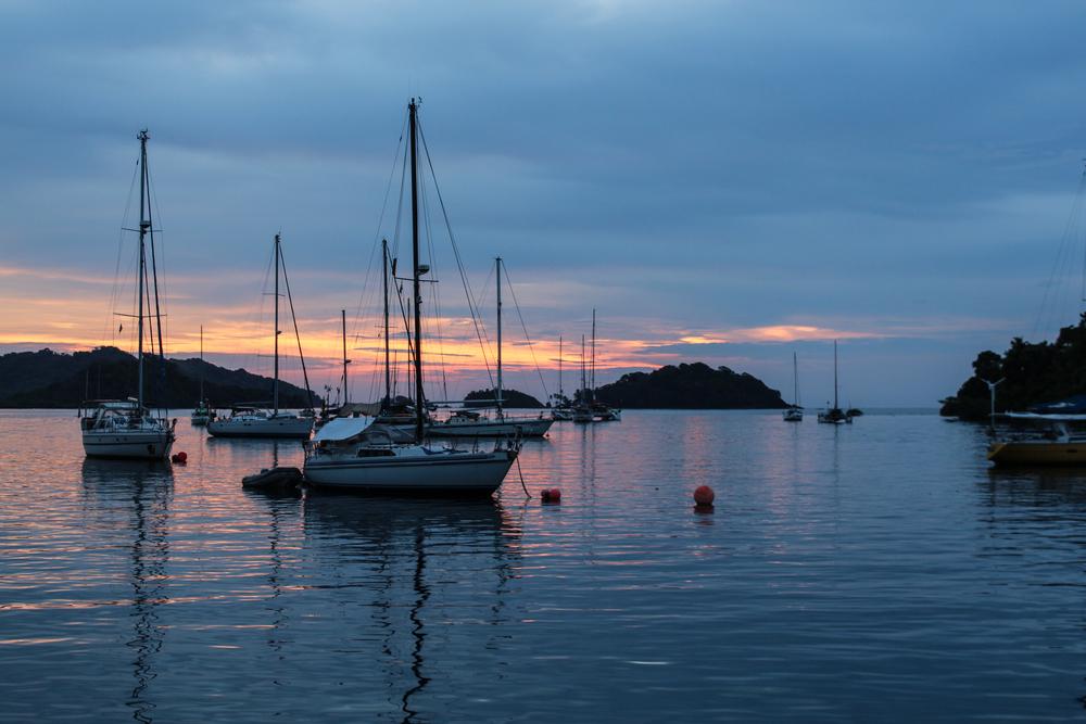 Boats at sunset, nestled in the bay near Monkey Island