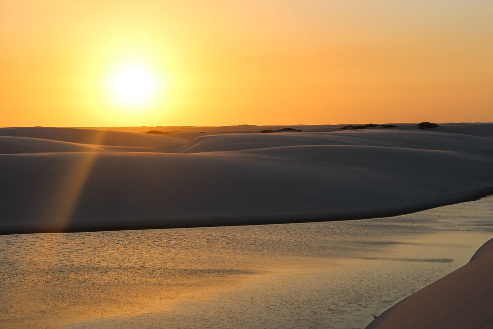 The sun comes down on the dunes at Lençois Maranheses